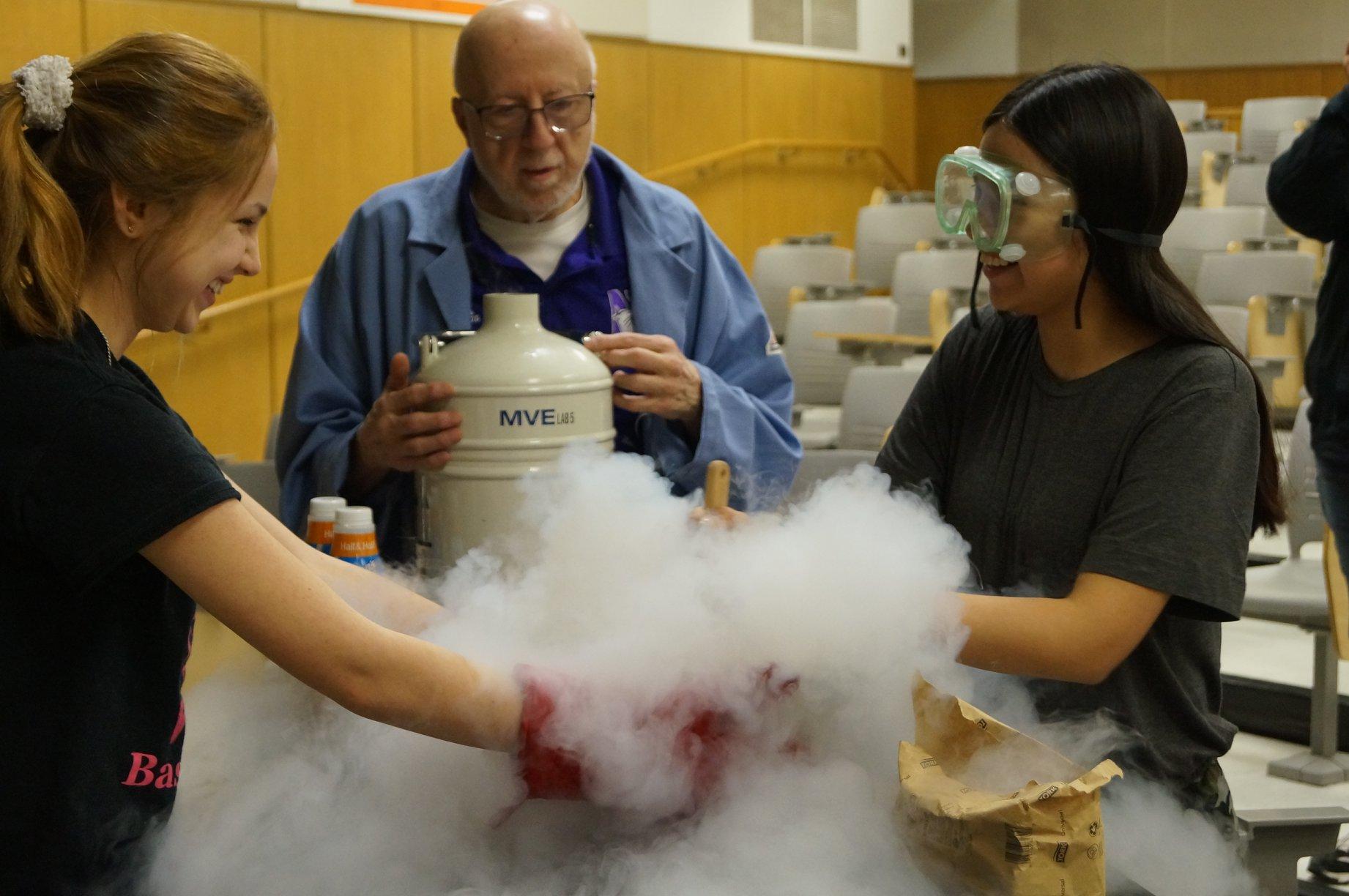 Prof. Art Schmidt makes liquid Nitrogen ice cream with the girls during his Magic of Physics Show, March 2019